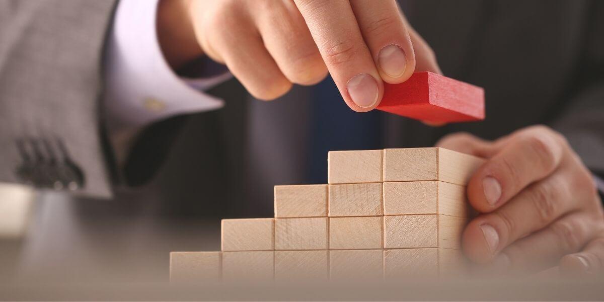 Block pyramid depicting healthcare strategies increasing in value.
