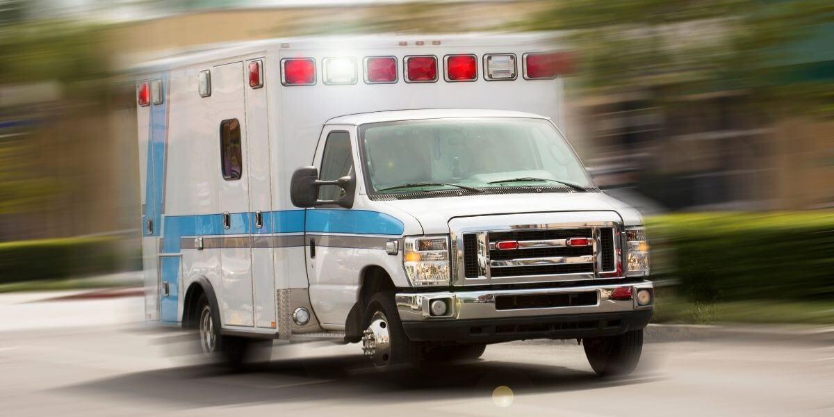 Ambulance speeding down the road.
