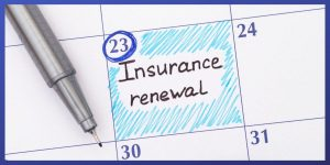 Calendar with date marked for health insurance renewal.