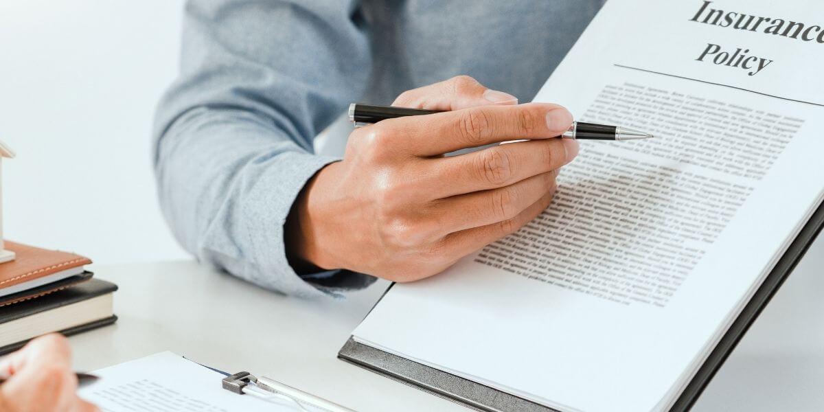 Health insurance advisor explaining plan details to client.